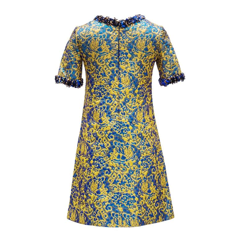 1966/67 Yves Saint Laurent Rive Gauche Divine Cocktail Dress  This is a divine short trapeze cocktail dress ; broché gold and blu .  Short sleeves and neck embroidered with gold and blue pearls and sequins   few sequins missing but invisible when