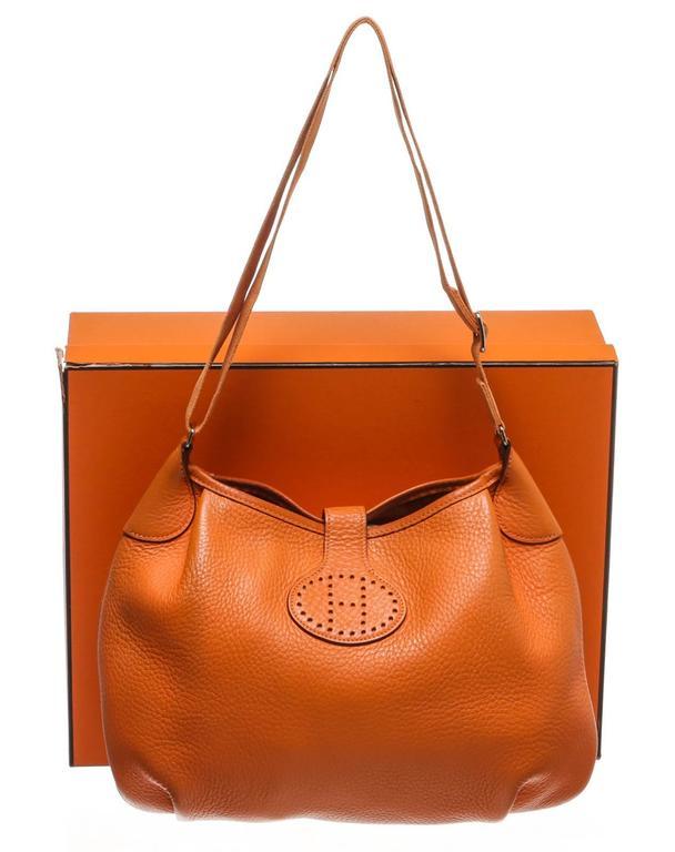 This Hermes Orange Leather Crossbody Handbag is no longer available.