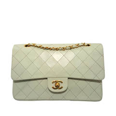 Lovely Vintage Cream Chanel Double Flap Classic with Gold Hardware.