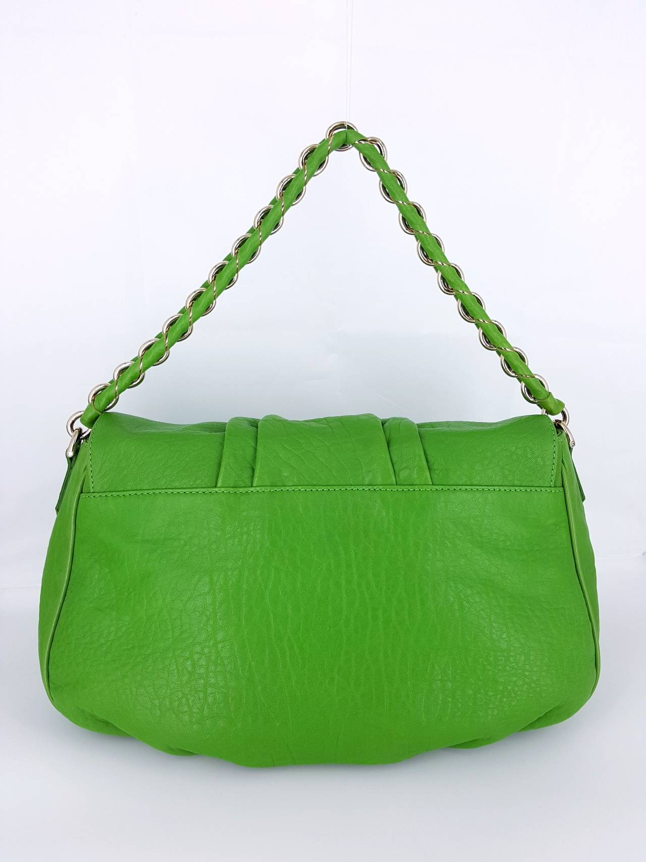 What a great color Fendi in Kelly Green Leather and silver hardware.  The large silver FF magnetic closure and metal on the shoulder strap really set this off nicely.  The soft textured leather makes it comfortable to carry.  There is a large