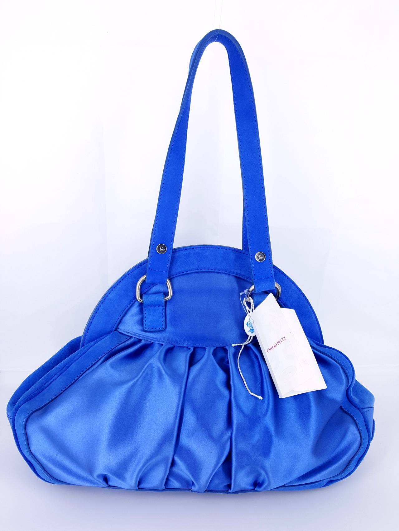 Offered for sale is this great cobalt blue Pucci handbag.  This is an awesome color with a fun interior.  It is Satin with suede trim.  The interior has 1 zippered pocket.  Pucci always has the best blues.  New with tags, but from about 4 years ago,