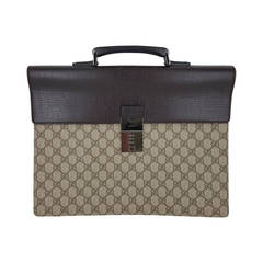 """Vintage GUCCI Briefcase In """"GG"""" Print Canvas and Brown Leather Trim."""
