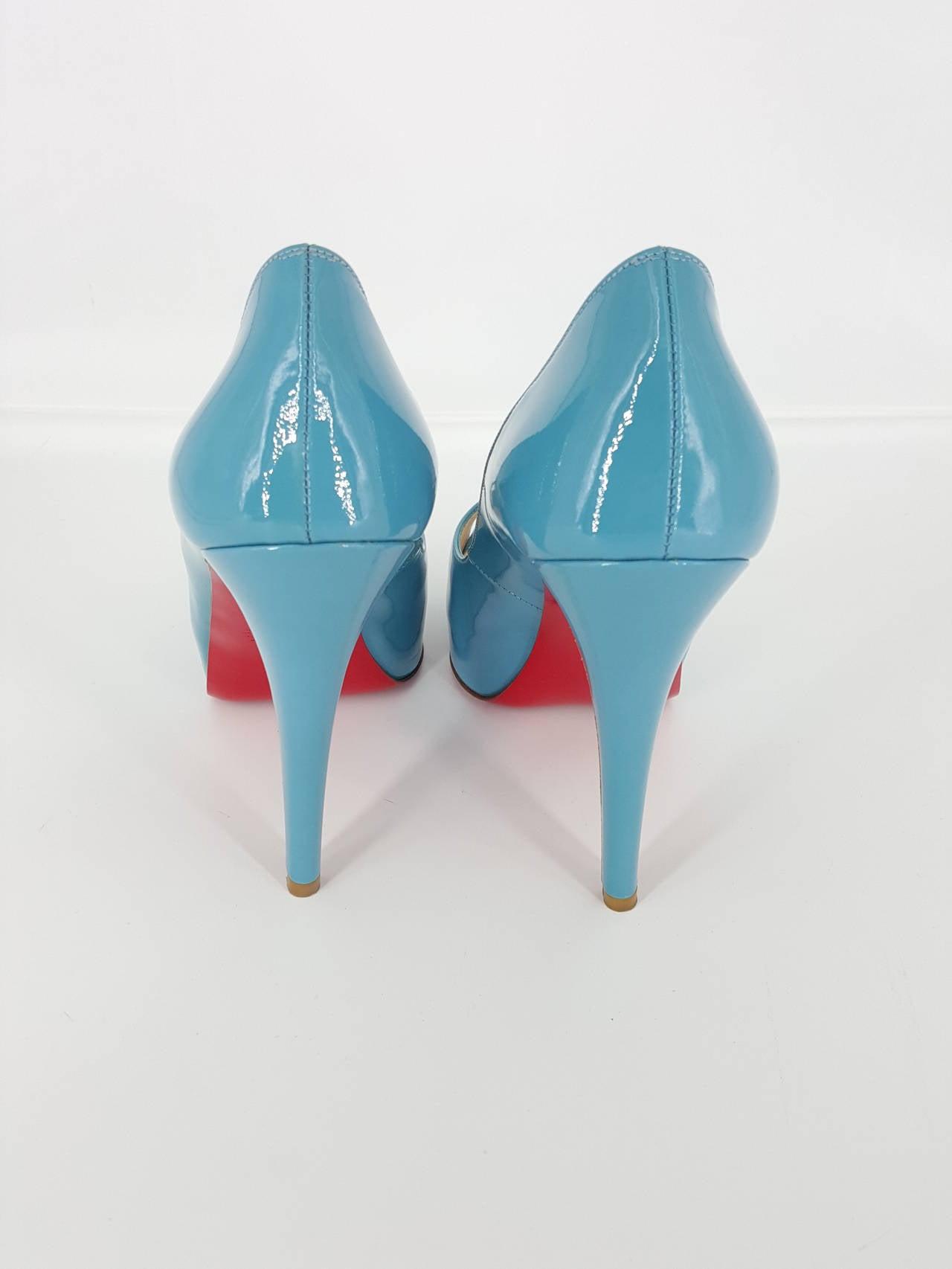 "Christian Louboutin Turquoise Patent Leather Peep Toe Pumps.  Size 36 1/2"" 3"