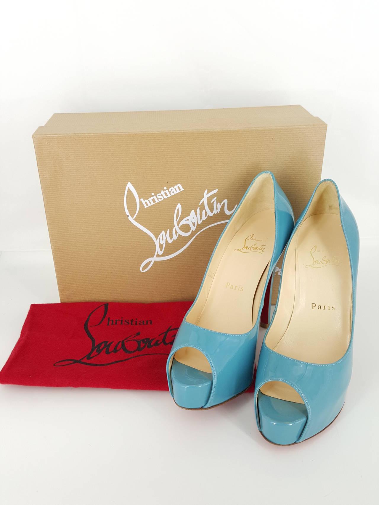 "Christian Louboutin Turquoise Patent Leather Peep Toe Pumps.  Size 36 1/2"" 5"