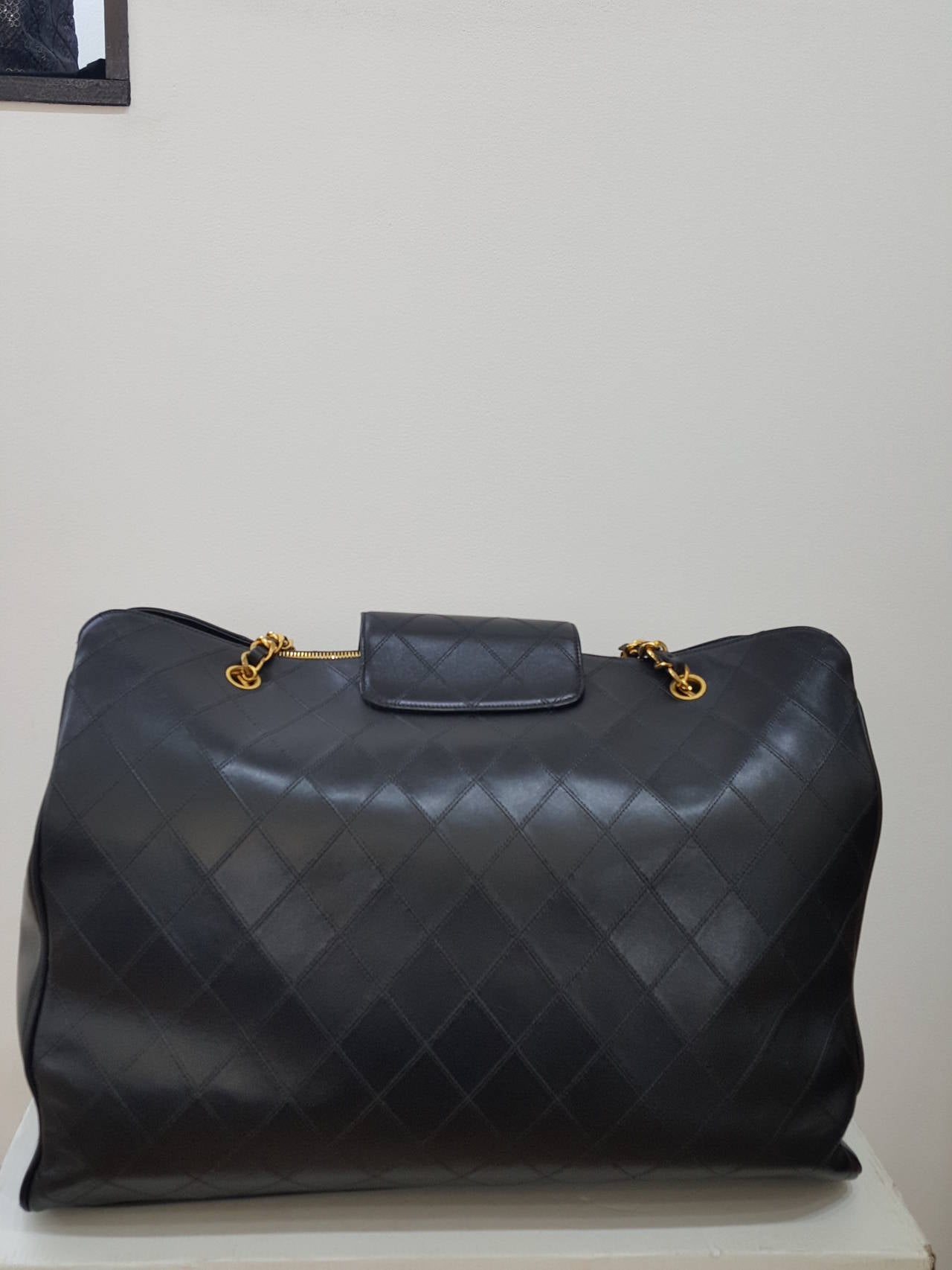 "Offered for sale is this fabulous very sought after Chanel XL Jumbo weekender overnight bag in quilted leather from 1990's.  Perfect size for a carry on.  This great piece has never been used.  The large ""CC's"" make the bag.  There are multiple"