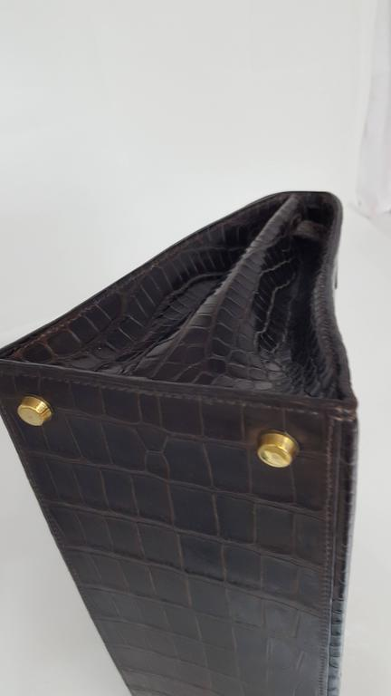Gray Hermes Dark Brown Shiny Crocodile Kelly 28 cm With Gold Hardware  For Sale