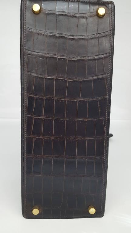 Women's or Men's Hermes Dark Brown Shiny Crocodile Kelly 28 cm With Gold Hardware  For Sale
