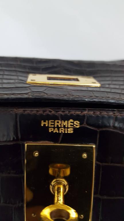 Hermes Dark Brown Shiny Crocodile Kelly 28 cm With Gold Hardware  For Sale 1