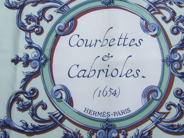 """AMAZING AND BEAUTIFUL AUTHENTIC HERMES SCARF  Pattern: """"Courbettes et Cabrioles"""" (Low bows and Capers)  Made in France  Designed by Francoise Faconnet in 1962  Made of 100 Silk  Colorways: Navy Blue, Blue, White, Brown,"""