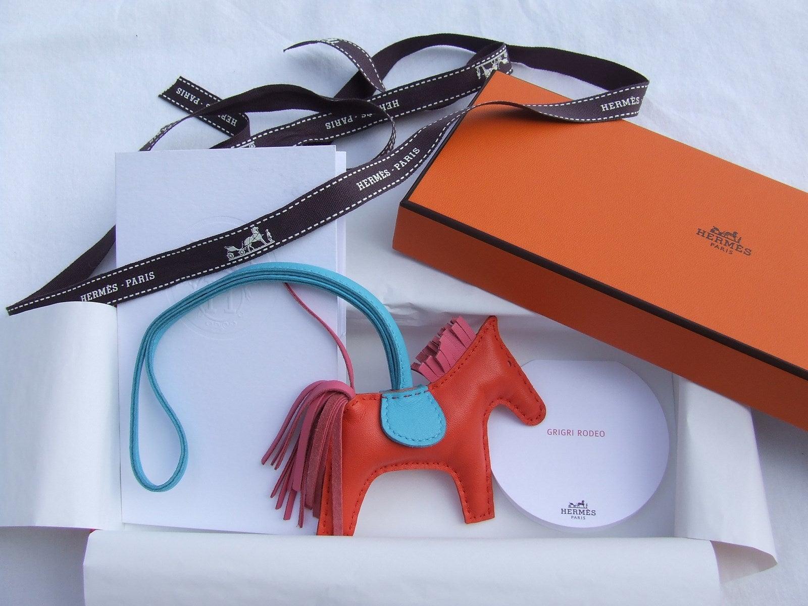 e6b1b47ffb Hermes Grigri Rodeo Horse Kelly Birkin Bag Charm Orange Rose Bleu PM at  1stdibs