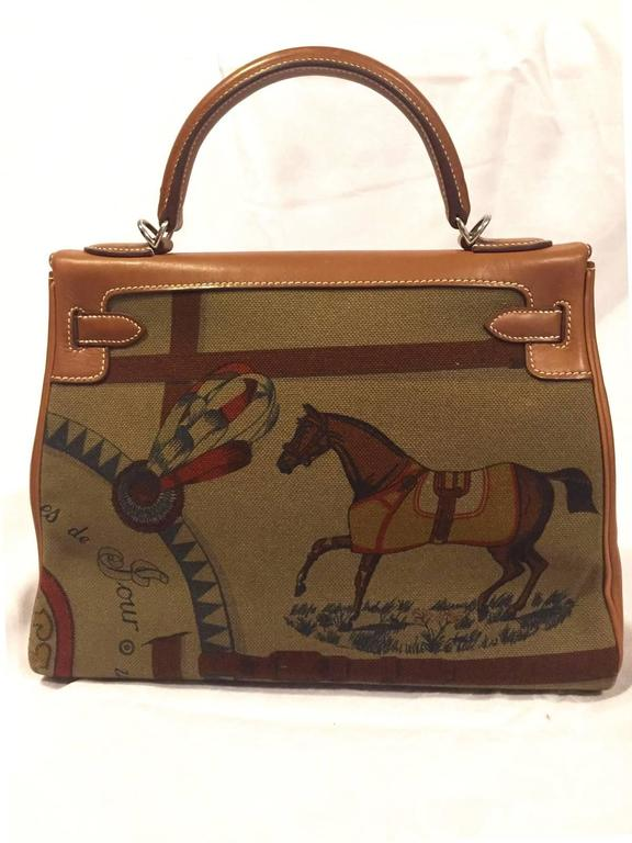 """Beautiful Authentic Hermes Bag  Super Rare, Special Edition !  """"KELLY""""  Made in France  Stamp N in a square (2010)  Made of Barenia Leather, Canvas (toile) and Palladium Plated Hardware (Silver-tone)  Shoulder strap is made of Leather and"""