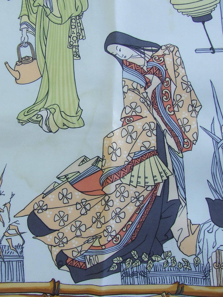 Beautiful Authentic Hermes Scarf  Pattern: Geishas  Designed by Françoise Heron in 1966  Rare and collectible scarf !  Made in France  Made of 100% Silk  Colorways: Light Blue Background, multicolored drawings