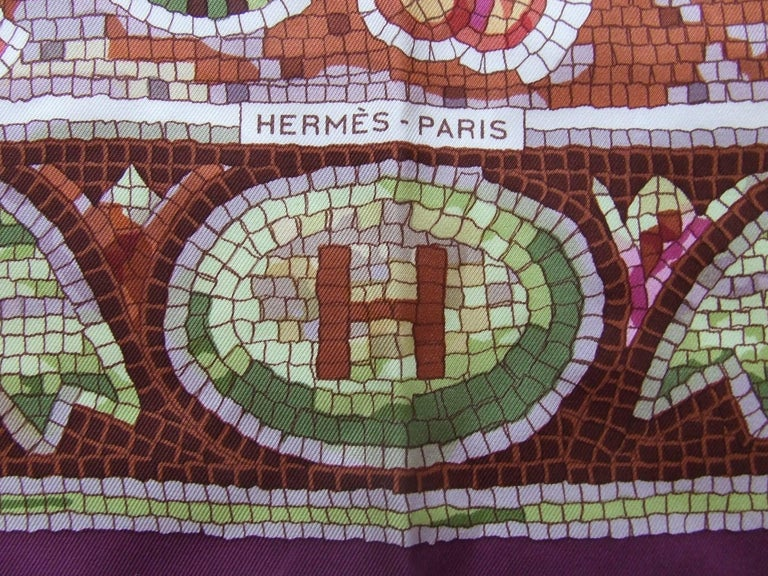"Absolutely Beautiful Authentic Hermes Scarf  Pattern: ""Pavement""  Designed by Maurice Trenchant in 1970. This one is a reissue  Made in France  Made of 100% Silk  Colorways: Purple, Green, Pink, Orange, Light Brown  Some pictures were made"