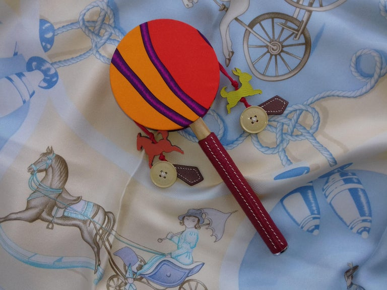 Authentic Hermès Tambourine  Cutest rattle ever !  Made of Silk, Leather and Wood  Colorways: Mainly Orange and Pink  Made for the 2016 Hong Kong Mid Autumn Festival