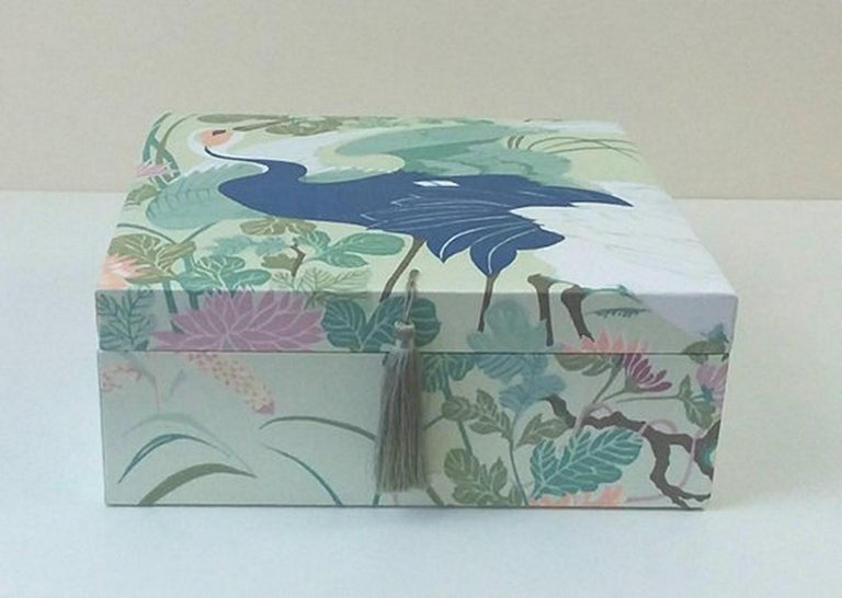 Beautiful storage box, Perfect for storing your Hermès scarves !  Made of wood cardboard and covered with Satin Cotton Fabric  The lid is embellished with a green pompom  Pattern: Birds, Trees, Leaves, Flowers  Colorways: Pastel Shades of Green,