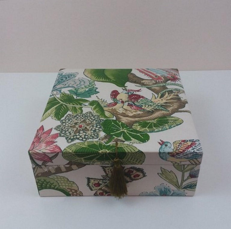 Beautiful storage box, Perfect for storing your Hermès scarves !  Made of wood cardboard and covered with Cotton Fabric  The lid is embellished with a khaki pompom  Pattern: Birds, Tree Branch, Flowers, Leaves  Colorways: Ivory, Green, Pink, Blue,