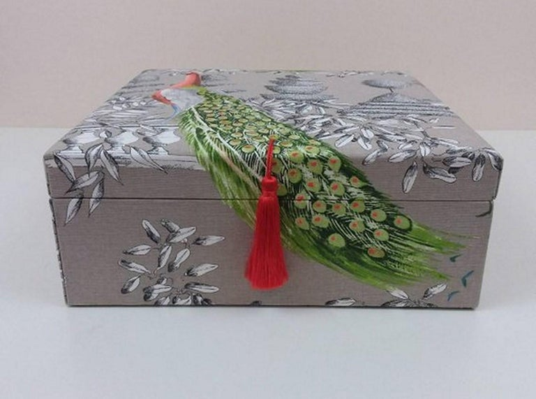 Beautiful storage box entirely handmade  Perfect for storing your Hermès scarves !  Made in France  Made of Wood Cardboard  Covered with Cotton Fabric  The lid is lightly padded and embellished with an orange pompom  Pattern: Birds  Colorways: Grey,