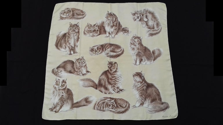 Please Notice: The background is Vanilla (issue of color rendering on photos)  Extremely Rare Authentic Hermès Vintage Scarf  Pattern: Chats Persans (Persian Cats)  Designed in 1956 by Jacques de Poret (only 1 issue)  One of the rarest Hermès