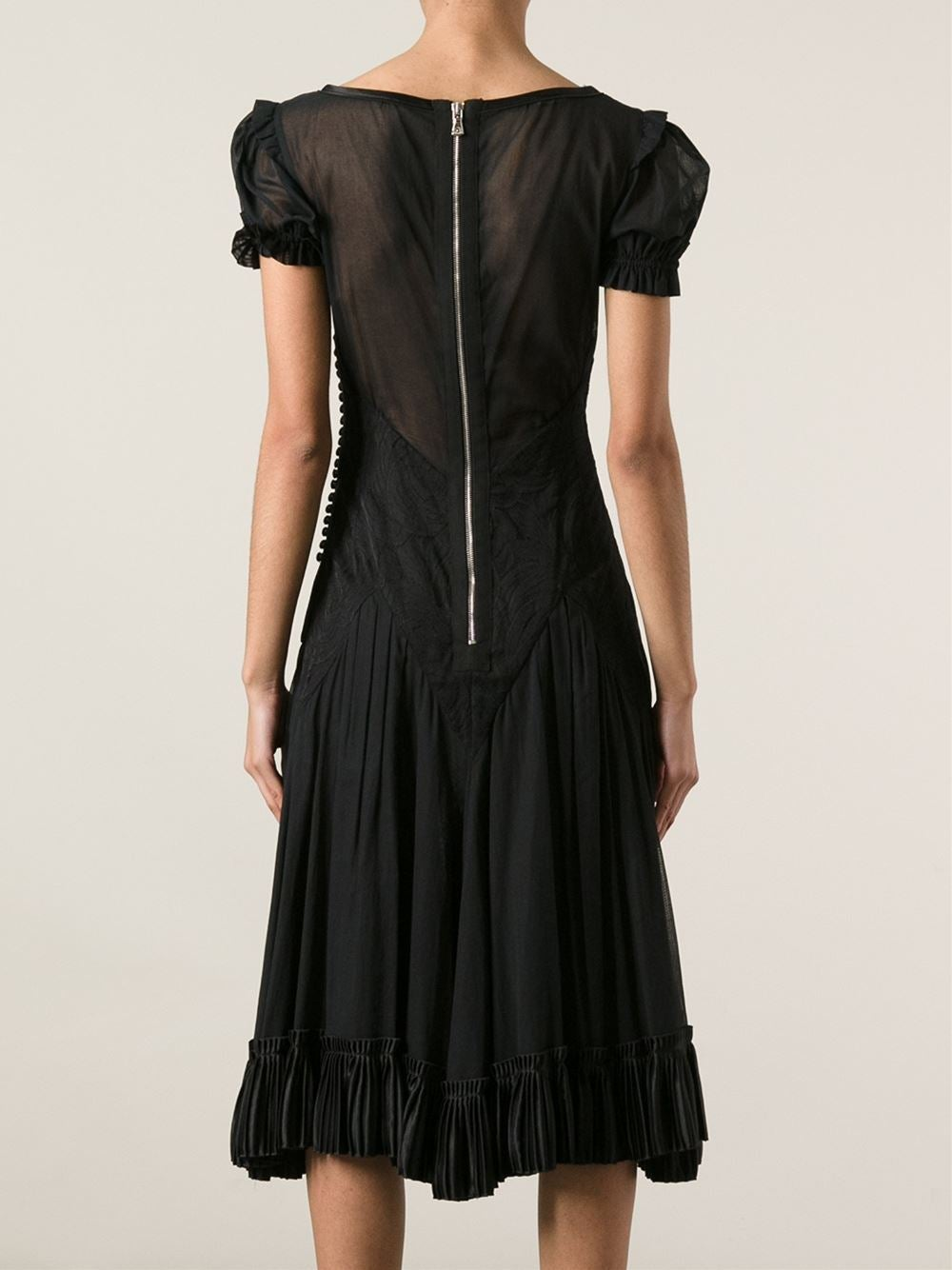 Black cotton blend semi sheer kaftan dress from Dolce & Gabbana Vintage featuring a scoop neck with a bow detail, short sleeves, a hook & eye fastening down the side, an embroidered pattern panel to the front and a knee length curtained skirt.