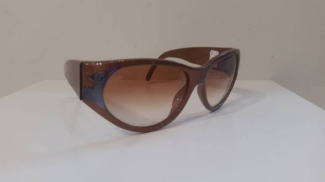 1980s Christian Dior Sunglasses. Really Dark bronze metallic with some grey paintures.