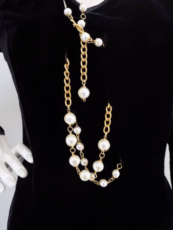 1970s Valentino black long dress with white pearls  Awesome one of a kind from Valentino still with tags in US size 10  Composition: 69 viscose 21 cupro 10 silk
