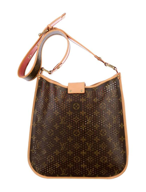 Limited Edition Spring 2006. Brown and tan monogram coated canvas Louis Vuitton Perforated Mussette Bag with vachetta leather trim, brass hardware, exterior pocket, adjustable shoulder strap, single interior pocket and lock applique at flap