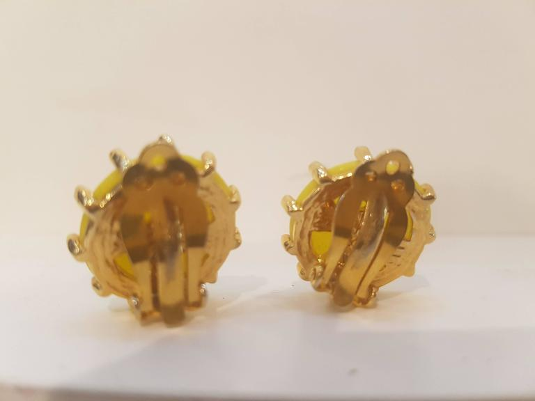 Women's or Men's 1980s Elsa Schiaparelli yellow clip-on earrings For Sale