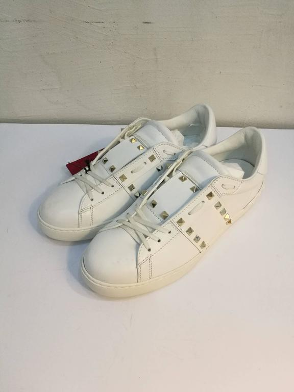 Valentino Garavani White Rockstuds Sneakers Still with box Size: 43 in italian size range Still with Tags Unworn