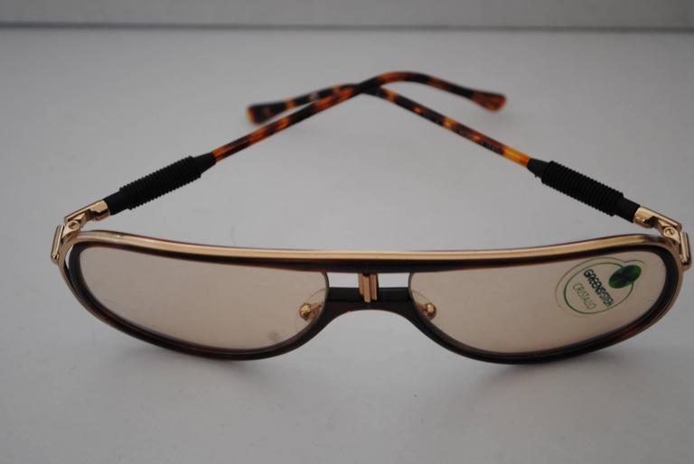 Alitalia Brown tortoise Sunglasses Totally made in italy in a limited edition  Measurements: 14 x 13.5 cm