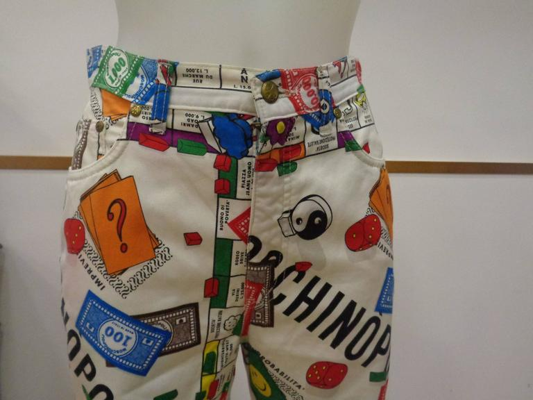 "Rare Moschino Iconic Collection  ""Moschinopoly"" Print trousers Rare collection inspired at Monopoly by Moschino totally made in italy in size 29 High waisted, iconic print that features allover monopoly print in a super soft cotton. Brass"