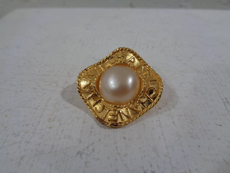 Women's or Men's Chanel gold tone faux white pearls clip on earrings For Sale