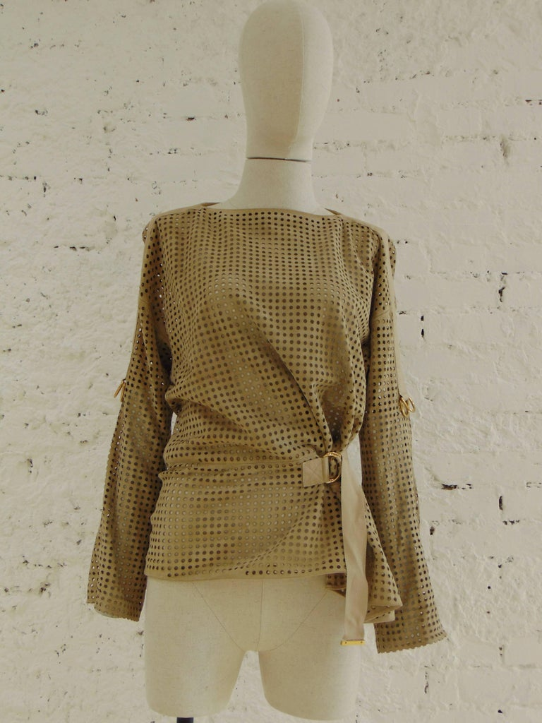 Tom Ford beije leather shirt   perforated leather in beije nude tone shirt totally madei n italy in size 44 embellished with gold tone hardware belt closure
