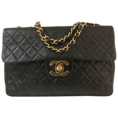 Chanel Black leather gold hardware maxi jumbo shoulder bag