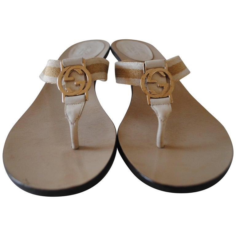 5a128a8f09a5 Gucci Cream GG Gold Logo Sandals For Sale at 1stdibs