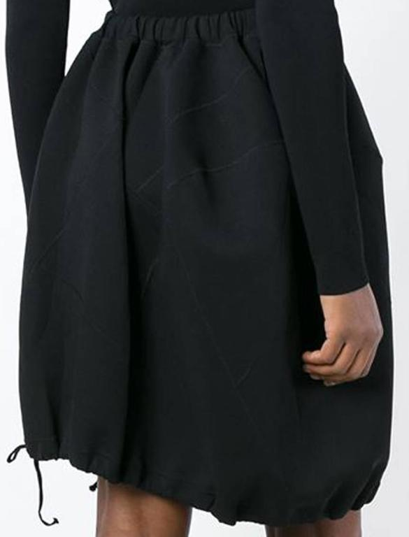 Gorgeous Comme Des Garçons by Rei Kawakubo black drawstring detail cocoon skirt featuring an elasticated waistband, drawstring details. In excellent vintage condition. Made in Japan. We guarantee you will receive this gorgeous skirt as described
