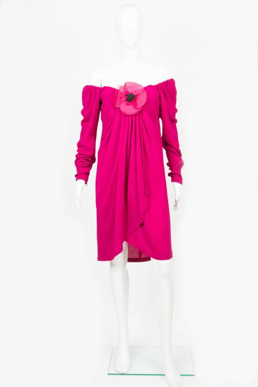 1990s red fuchsia Saint Laurent cocktail crepe dress featuring a large neckline,with a corset under to keep the perfect fitting, a large gorgeous front flower,and a center front slit with  wrapped effect. Crepe dress (60%viscose,40%acetate) In