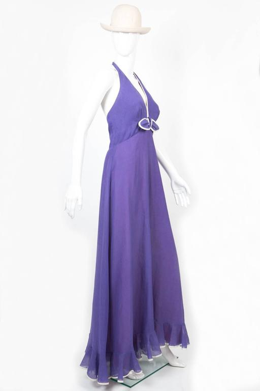 Fantastic 70s ELLIETTE LEWIS (Miss Elliette) thin cotton voile purple dress featuring an off white piping, a center back zip with a center back button. In excellent vintage condition. Made in USA. We guarantee you will receive this gorgeous dress as