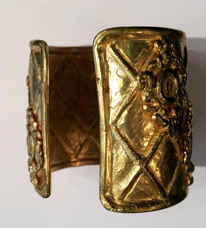 1980s Rochas goldtone large cuff bracelet featuring a delicate work.