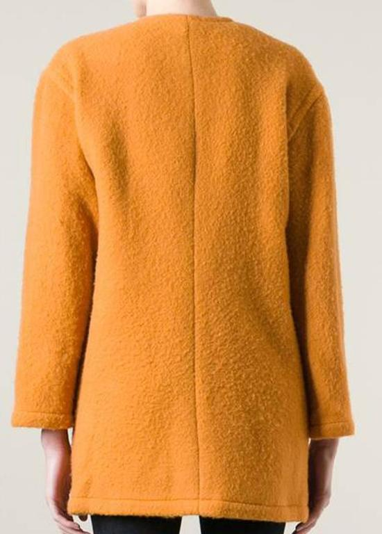 Guy Laroche sunflower unlined wool-mohair blend single breasted coat featuring a collarless design, a front button fastening, front pockets, long sleeves and gold-tone round buttons. (90%wool, 10%mohair)
