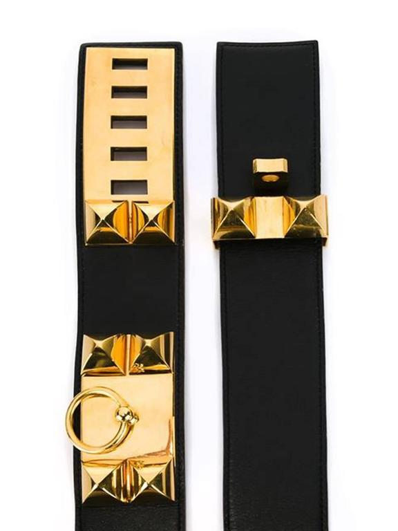 Hermes 1993s Black Collier de Chien Medor belt in calfskin leather featuring gold plated studded hardware, tonal stitching and adjustable gold plated closure, pitted a W in a round dated: 1993 and an internal logo stamp.