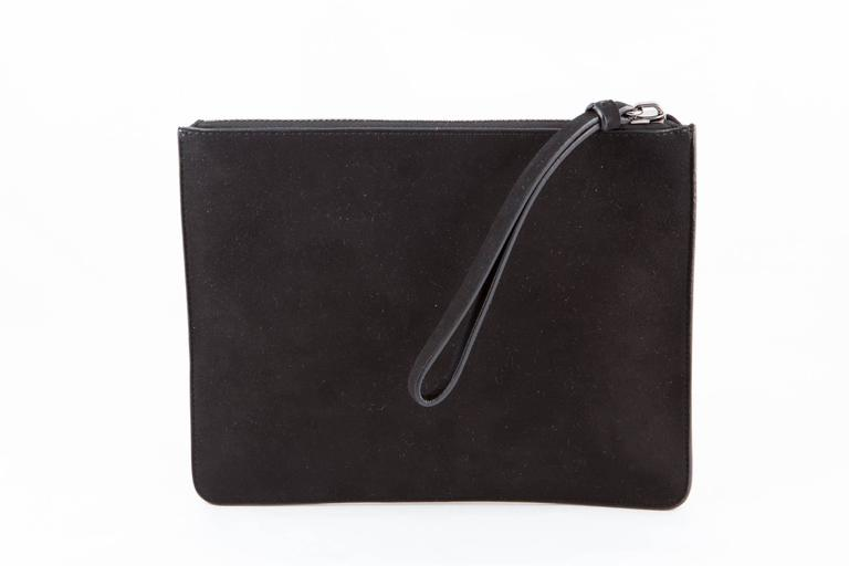 Giuseppe Zanotti black evening suede lamb clutch featuring a silver tone studs face and a plain black ace, a top handle (7in. (18cm)), a top zip opening,  inside in leather lining, a small pocket, and brand stamp. In excellent vintage condition (New