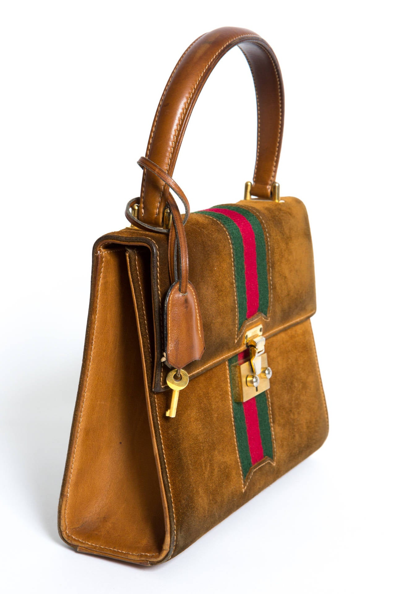 """1970 gorgeous & rare handle Gucci bag delivered in his original box, as an inspiration for the new season """"Spring 2016"""" Gucci collection (see photo). The bag is mixed suede and leather featuring a front lock gold tone hardware which comes with his"""