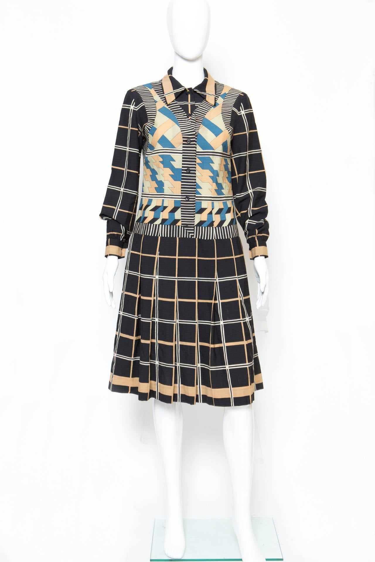 1970s Lanvin wool dress (70% wool 30% nylon) featuring a placed print, a front button opening, a pleated skirt, long sleeves with buttoned cuffs. In good vintage condition. Made in France. Estimated size Estimated size 36fr/ US4/ UK8 We guarantee