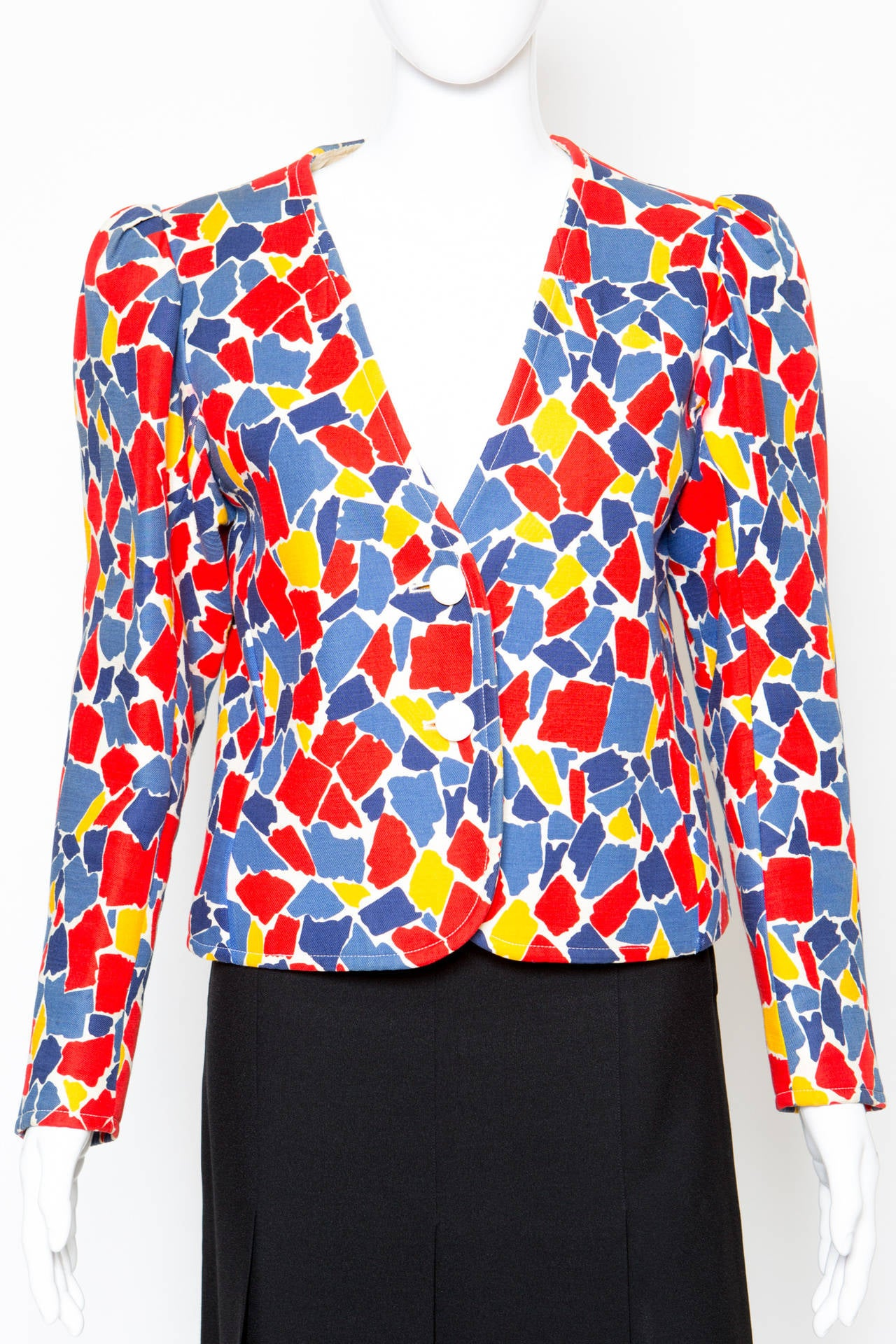 "1980s Yves Saint Laurent multico printed jacket featuring a geometric yellow, blue & red geometric pattern in a heavy wool fabric, fancy pleats at sleeves, deep ""V"" neck, two off-white front buttons. Across shoulder: 38cm.