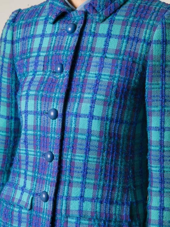 1960s  turquoise blue wool Philippe Venet jacket featuring a blue & purple check woven pattern, a front button opening, front patched pocket, a changing tone lilac silk lining. In good vintage condition. Made in France. Estimated size: 36fr/ US4/