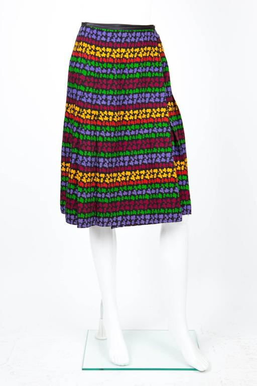 Saint Laurent multicolored wool etamine wrapped skirt featuring a multicolored print on a black ground, a thin black satin waistband. In excellent vintage condition. Made in France. We guarantee you will receive this iconic skirt as described and