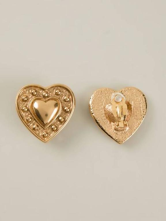 Yves Saint Laurent gold-tone heart clip on earrings. In excellent vintage condition. Made in France. 1,5in. (4cm) X 1,5in. (4cm)