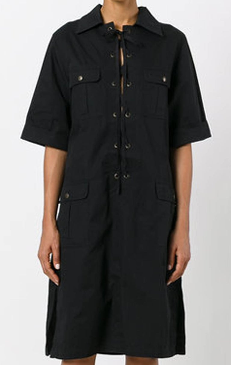Black cotton Saint Laurent safari shirt dress  featuring a classic collar, short sleeves, a drawstring fastening and front pockets.  In excellent vintage condition. Made in France.   Estimated size 40fr/US8/UK12 We guarantee you will receive this