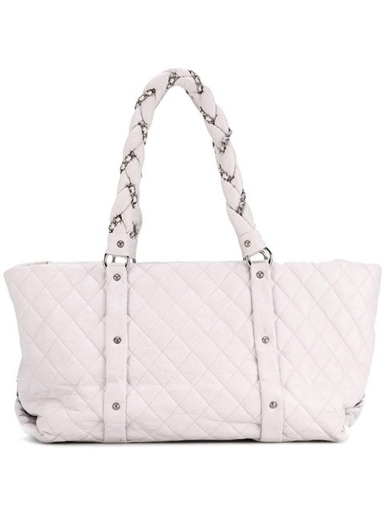 Large Chanel off-white with a little lilac tone color in  and silver lambskin leather quilted tote bag featuring round top handles, an inside logo lining, a top zip closure and an internal zipped pocket.  In excellent vintage condition. Made in