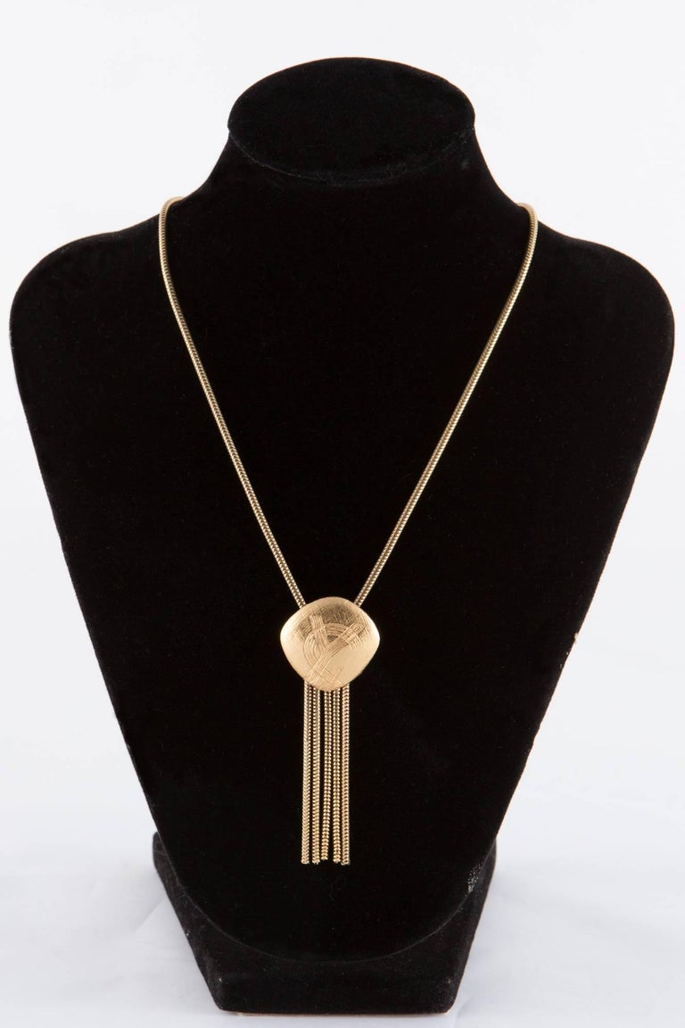 8003574aa79 ... metal necklace featuring a center logo medal with gold tone. Gold Tone  Yves Saint Laurent Necklace In Excellent Condition For Sale In Paris, FR